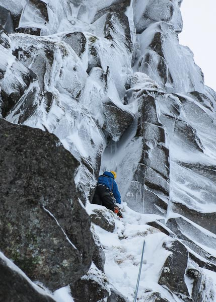 Roger Webb moving up to the base of the cave pitch on the first ascent of Insurgent (VI,7) on Sinister Buttress, Lochnagar. This steep buttress is the least climbed feature in the Southern Sector. (Photo Simon Richardson)