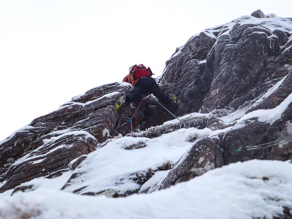 Jonathan Preston moving through the barrier rock band on the second ascent of Potala Buttress on An Teallach. This is probably the pint where a sling for aid was used on the first ascent by Dave Broadhead and Des Rubens in January 1987. (Photo Andy Nisbet)