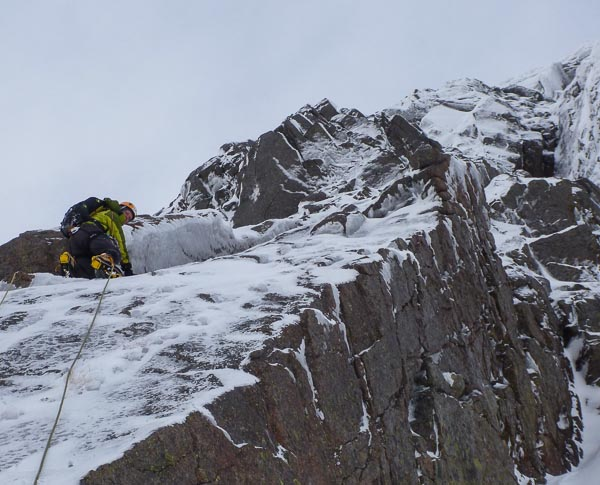 Simon Yearsley climbing the initial ramp on the first pitch of Sentinel Buttress (V,6) on Beinn a'Bhuird during the first ascent. The route was in very icy conditions, with heavy rime and hoar on most of the buttress. In leaner conditions the route may be significantly easier... or significantly harder! (Photo Neil Silver)