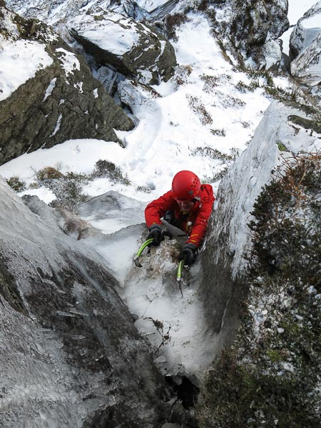 Henning Wackerhage on the first ascent of The Art of Growing Old Gracefully, a new Grade III,4 gully in Corrie Farchal, Glen Clova. (Photo Simon Richardson)
