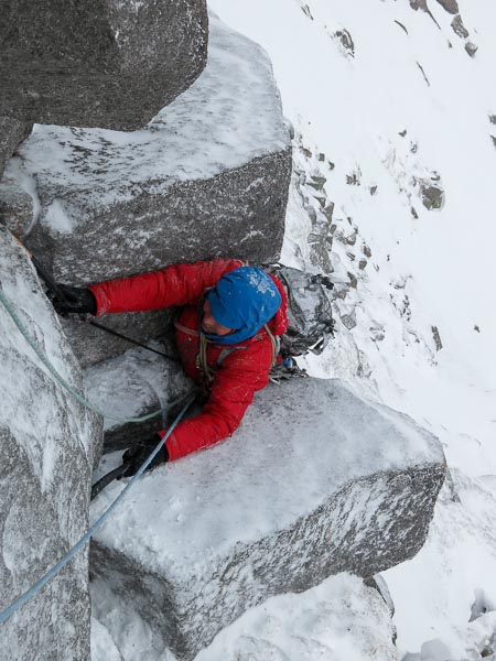 Roger Webb pulling through the roof on the crux roof of Tempting Fate (V,6) in Coire Ruadh on Braeriach. The climbing potential of this rarely visited corrie on the north side of the mountain has been largely ignored until recently. (Photo Simon Richardson)