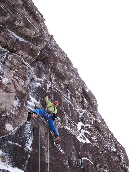 Pete Macpherson ion the first ascent of Suspended Animation (VIII,9), a new four-pitch long mixed route on Suspense Wall in Coire na Feola on Beinn Bhan. (Photo Martin Moran)