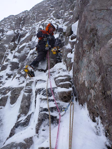 Simon Yearsley starting up the second pitch of Beggars Belief (VII,7) on Ben Nevis during the first ascet. The crux wall is visible diagonally above his right shoulder. (Photo Helen Rennard)