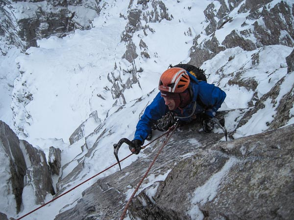 Jim Higgins on the second pitch of Mistral (VII,8) on Beinn Eighe. This summer E1 5b on West Central Wall saw its first winter ascent by the ubiquitous partnership of Davison and Nisbet way back in 1991. (Photo Malcolm Bass)