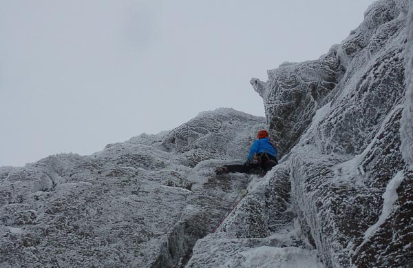 Dafydd Morris contemplating the top wall/corner past the rock finger on the second pitch of Hangover (VI,6) on Creag Tharsuinn in Arrochar. (Photo Matt Buchanan)
