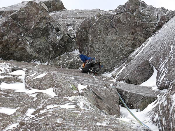 Iain Small arranging protection below the crux overhang on the first ascent of No Success Like Failure (IX,8) on Ben Nevis. The route continues up the vertical wall above the double roof to exit just right of the overhang on the skyline. (Photo Simon Richardson)