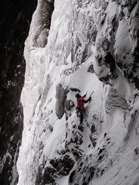 Crag Jones on the spectacular fourth pitch of Raven's Gully (V,5) on Buachaille Etive Mor. There are two finishes to the standard line – either climb the chimney on the right (awkward in lean conditions), or traverse left and finish up icy grooves as shown above. (Photo Stephen Reid)