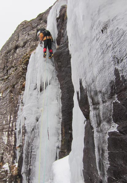 Des Rubens climbing the steep initial pillar of Three Chimneys, Left Hand (IV,4) on Cul Beag during the first ascent. (Photo Dave Broadhead)