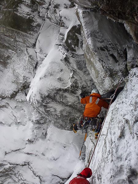 Jake Thackrey struggling to place a hex on the crux of Silence of the Rams (V,6) on The Cobbler. The route was climbed on December 30 when storm force winds were raging across the country. (Photo Andy Bain)