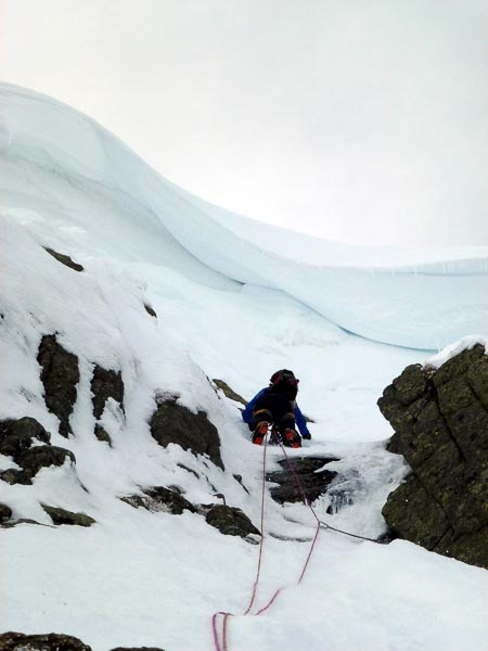 "Sandy Allan approaching the large cornice on the first ascent of Adventure (V,5) in Garbh Choire Mor on Braeriach. ""It's not the quality of the climbing that makes the day here - it's the whole adventure"", said Sandy on the way down. ""And we had had an adventurous day,"" confirms Andy Nisbet. (Photo Sandy Allan)"