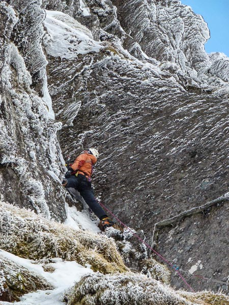 Jonathan Preston contemplating the crux groove of Zee Zee Top (VI,6) on Stob a'Choire Mheadhoin during the first ascent. (Photo Andy Nisbet)