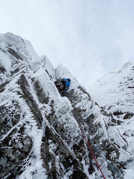Andy Inglis on the first ascent of Moonshine (VI,7) on Stob Coire nan Lochan. This steep hanging groove branches out left from Moonshadow on the subsidiary buttress that over looks Twisting Gully. (Photo Neil Adams)