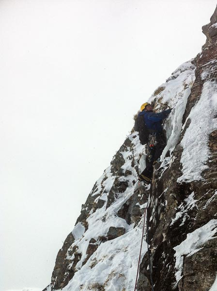 Neil Wilson on pitch 5 of Reuben's Groove (IV,5) on Beinn Dearg during the first ascent. The seven-pitch route takes the broad tiered buttress between Wee Freeze Gully and Edgeway. (Photo James Edwards)