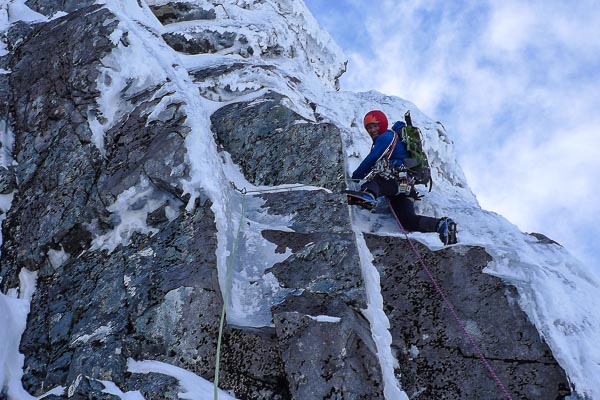 Nick Bullock enjoying the first ascent of Spaced Out (VII,7) on Ben Nevis. Despite the smile, continuous detaching ice made this an exciting ascent. (Photo Iain Small)