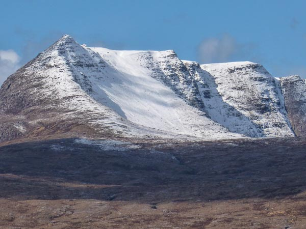 Perfect spring conditions on Ben Mor Coigach with the North-East Ridge containing the Reid-Crofton Grade III and Hyperborea (IV,5) in the centre. (Photo Bob Reid)