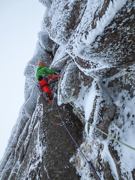 Pete Benson climbing the challenging second pitch of Nevermore (X,10) during the fourth attempt in March 2013. Extreme cold and dwindling daylight forced retreat from two pitches above. The first ascent of this highly significant route fell to Nick Bullock and Guy Robertson several weeks later. (Photo Guy Robertson)