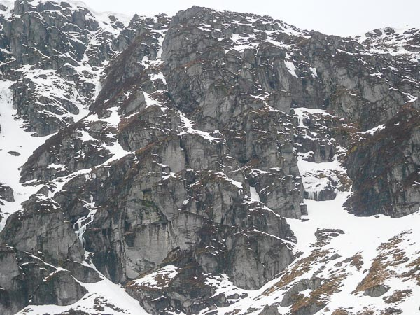 A view of the lower right side of Winter Corrie in Clova, with the prominent line of Grampian Club Buttress (IV,5) cleaving the middle of the lower buttress in the centre of the picture. This photo was taken following a thaw two weeks after the ascent. The icy smears of the Lynx Variation (IV,4) can be seen running down the right wall of the introductory gully of Wildcat Wall bounding the buttress on the left. (Photo Forrest Templeton)
