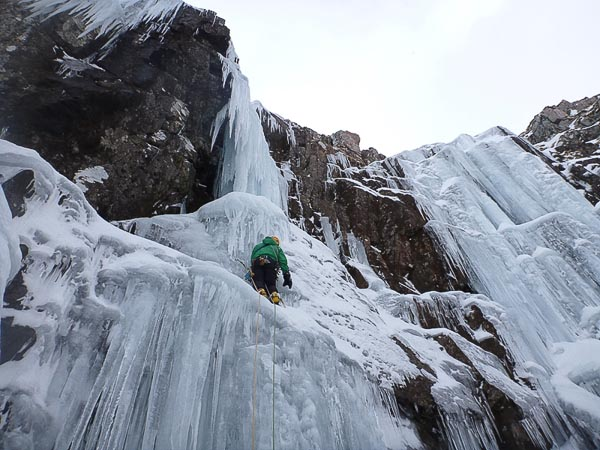 Simon Yearsley on the first ascent of 'Left-Hand Amigo (tech 5/6), with the icefall of Central Amigo (tech 5/6) and Right-Hand Amigo (tech 5/6) to the right. (Photo Chris Pasteur)