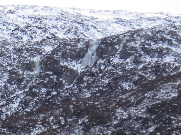 The top icefall of Daft Laddie, a new Grade III in Coire Crom in Glen Affric, can be seen in the centre of the photo. The rest of the route is hidden below and left. (Photo Matt Smith)