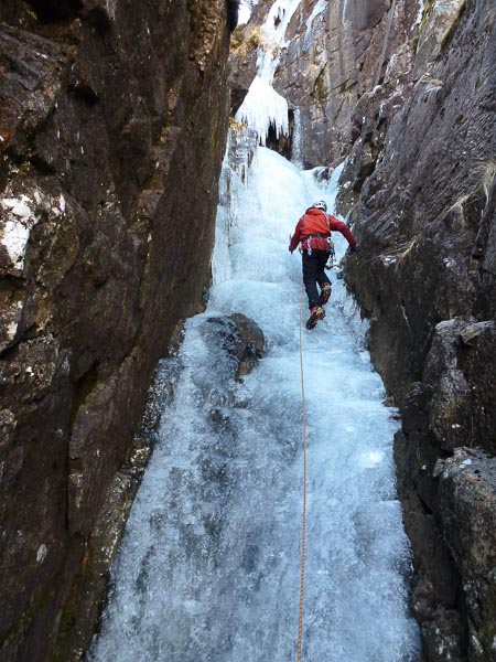 Dave McGimpsey on the first ascent of Allt Coire nan Arr (III) in Applecross. The first ascensionists did not carry ice screws, so had to lead the route with minimum protection. Even so, Andy Nisbet commented afterwards that it was a 'relaxing day out.' (Photo Andy Nisbet)