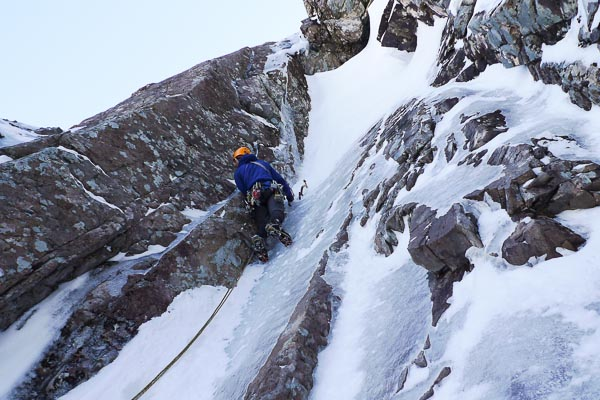 Iain Small approaching the crux of Suburban Spaceman (VII,8), a new start to Urban Spaceman (VII,7) on the Orion Face. Climbing the collapsing snow to reach the thinly iced overhang proved to be as testing as pulling through the thinly iced roof above. (Photo Iain Small Collection)