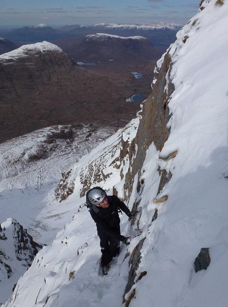 Dave McGimpsey enjoying superb late season conditions on the Northern Pinnacles of Liathach in Torridon after making the first ascent of Spring Roll (IV,4) on Meall Dearg. (Photo Andy Nisbet)