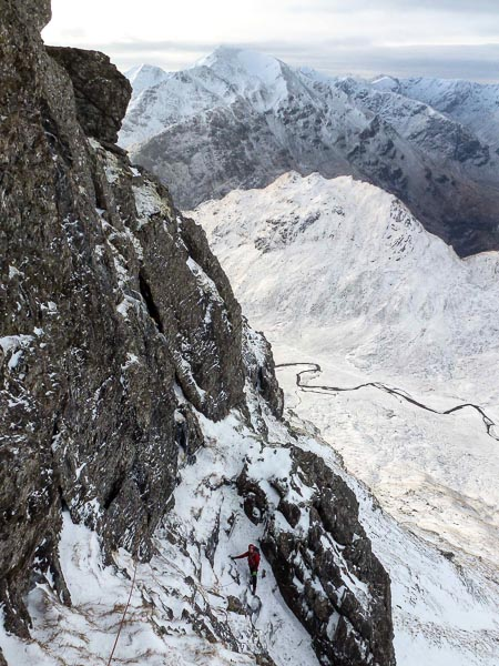Dave McGimpsey high on the West Face of Aonach Beag during the first winter ascent of North Buttress (III). The Mamores are in the background. (Photo Andy Nisbet)