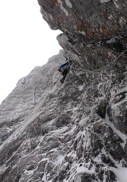 Iain Small leading the new Alternative Start to Avenging Angel on Ben Nevis. This perplexing area of overhanging grooves at the left end of Creag Coire na Ciste has yielded a number of excellent routes and variations in recent seasons. (Photo Tony Stone)