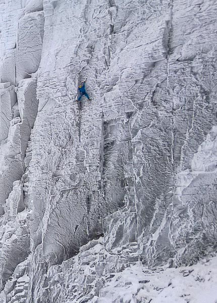 Greg Boswell making the first winter ascent of The Demon (IX,9) in Coire an Lochain in the Northern Corries. The route starts from the lower left corner of the wall, whilst the winter line of Demon Direct, first climbed by Alan Mullin in 2001, takes the right-facing corner just to the right. Both routes then continue up the same upper crack system. (Photo Stewart Whiting)
