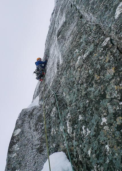 Iain Small climbing the crucial second pitch on the first winter ascent of Scansor (IX,9) on Stob Coire nan Lochan. This prominent line has seen at least four prior attempts that all came to a halt near this point. (Photo Tony Stone)