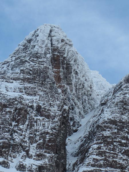 The great soaring groove of Last Orders (VII,8) cutting through the right side of Major Rib in Glas Tholl on An Teallach. This superlative line was takes one of the most compelling features in the Northern Highlands. The broad gully on the right is the Alley (II). (Photo Neil Adams)
