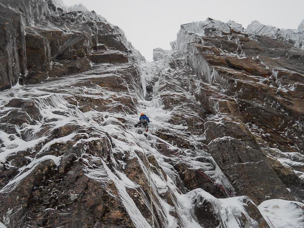 Iain Small leading the opening pitch of Vishnu (VII,7) on Beinn Eighe's Far East Wall during the second ascent. This prominent line, first climbed by Andy Nisbet and Andy Cunningham in February 1988, has waited over 25 years for a repeat. (Photo Murdoch Jamieson)