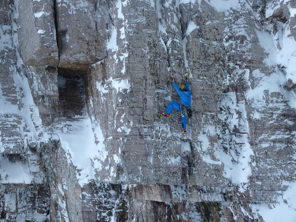 Greg Boswell on the first ascent of Making the Cut (VIII,8) on Beinn Eighe. The route climbs through the stepped roofs before taking the soaring crack line to the left of West Central Gully. (Photo Nick Bullock)