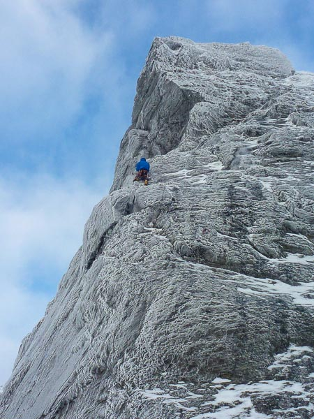 Andy Bain on the first pitch of Ardgarten Arete on The Cobbler. The new line of Ardgarten Blended (V,6) continues up the line on the right wall. (Photo Andy Bain Collection)