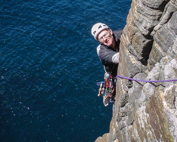 Colin Grant climbing the great Scottish sea cliff classic Prophecy of Drowning (E2) on Pabbay in the Outer Hebrides. Colin climbed at a high standard in summer and winter for over fifty years and was an inspiration for all that knew him. (Photo courtesy John Hutchinson)