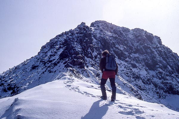 John Dalton making a rare traverse of the Rum Cuillin in winter conditions. The transitory nature of winter conditions on the mountains of the Inner Hebrides means that  completing such a traverse is an almost impossible expedition to plan. (Photo Iain Young)