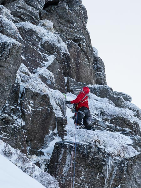 Henning Wackerhage moving up to the turfy headwall of Silver Threads Among The Gold (IV,5) on the first ascent. This four-pitch mixed route is located in Coire Farchal which lies just east of Winter Corrie on Driesh. (Archive Photo Simon Richardson)