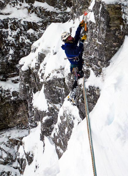 Steve Perry on the first ascent of Flying Saucer (VI,7) on Stob Ban. The route follows the line of North Ridge Route that is incorrectly marked in the SMC Ben Nevis guidebook. (Photo Andy Nisbet)