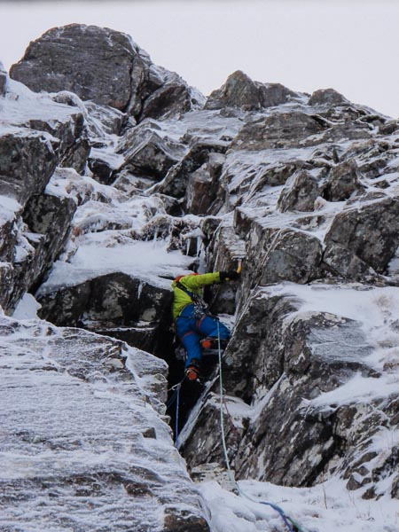 Pete Macpherson on the first ascent of Imperturbable (IV,5) on the South-West Face of Cona Mheall in the North-West Highlands. Cona Mheall is the mild-mannered cliff facing the steep and demanding Upper Crag of Beinn Dearg on the west side of Coire Ghranda. (Photo Roger Webb)