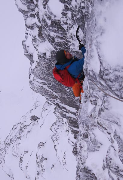 Roger Webb finishing the crux pitch of Tenterhooks (VII,8) on Ben Nevis during the first ascent. This steep icy mixed climb takes the steep wall between Central Rib Direct and Tinkerbell Direct of Creag Coire na Ciase. (Photo Simon Richardson)