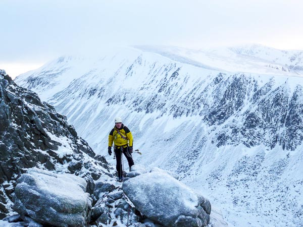 Jonathan Preston moving along the horizontal section at the top of El Dorado (III,5) on Lurcher's Crag on Cairn Gorm during the first ascent. The great defile of the Larig Ghru and the cliffs of Sron na Lairige can be seen behind. (Photo Andy Nisbet)