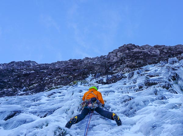 Guy Robertson leading the first pitch of The Greatest Show on Earth (X,10) on Cul Mor during the first ascent. The route continues up the wall above starting from the small ice smear up and left of Guy's head. The route goes into Scottish winter climbing history as the first on sight of a new Grade X. (Photo Greg Boswell)