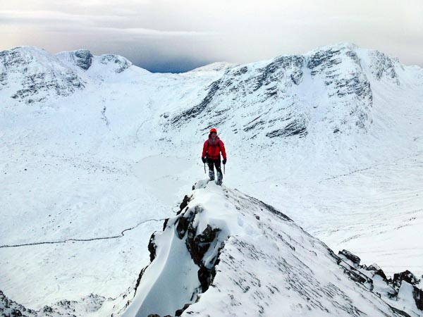 Sandy Allan on the final arete of Zeus (III) on Beinn Liath Mhor. Fuar Tholl and Sgurr Ruadh complete the backdrop. (Photo Andy Nisbet)