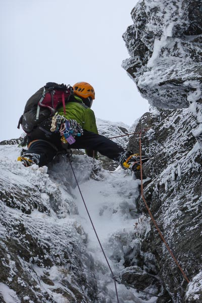 Matt Buchanan making the first winter ascent of Arch Chimney on Creag Tharsuinn in Arrochar. This was one of the last 'old school' summer routes on the cliff to receive a winter ascent. (Photo Dafyyd Morris)