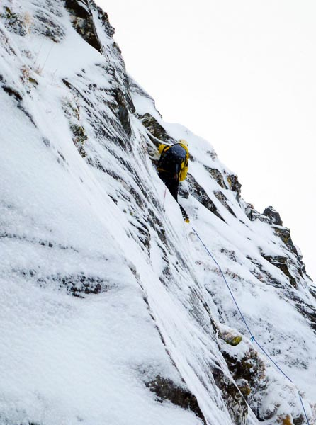 Jonathan Preston on the first ascent of Twerk (V,5) in Coire nan Eun deep in the Fannaichs. This little known cliff on the north side of An Coileachan has probably been visited only half a dozen times. (Photo Andy Nisbet)