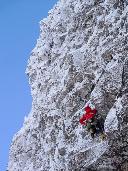 """Murdoch Jamieson climbing pitch 6 of The God Delusion (IX,9). """"This was a marvel of route finding and a lesson in rope management. Murdoch did a sterling job of extending everything, even at the cost of losing most of his hexes to complement his dwindling supply of quickdraws."""" (Photo Iain Small)"""