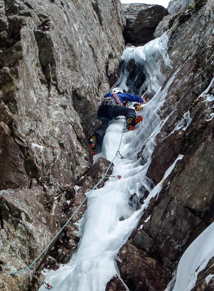 Steve Perry on the first ascent of the Right-Hand Branch (VII,7) to Bottleneck Gully on the West Dace of Aonach Beag. The crux ice umbrella above his head was protected with an upside down ice screw. (Photo Andy Nisbet)
