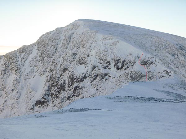 The North Face of Aonach Beag from the Aonach Mor-Aonach Beag Col with the line of Highway Robbery marked in red. The steep icefall of Stand and Deliver (V,5) is the next prominent lie to the left. The face has been in good condition recently and the rarely climbed Camilla (V,5) and Blackout (IV,5) have also seen ascents. (Photo Ken Applegate)