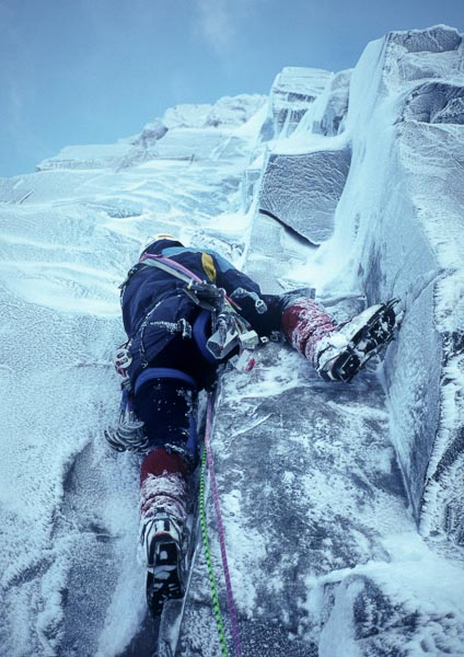 Chris Cartwright climbing the prominent V-groove of Enigma during the first winter ascent in January 1997. The route was first climbed in summer 1952 by Marshall, Cole and Oliver and was repeated in winter by Malcolm Bass and Andy Brown in January 2008. (Archive Photo Simon Richardson)