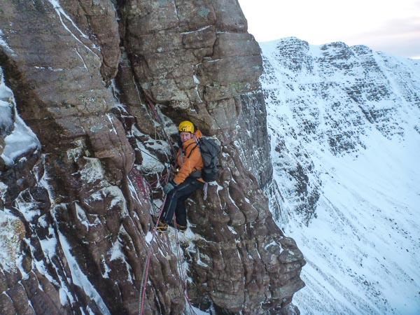 Neil Wilson on the first ascent of Sideshow (IV,6) on Cul Mor. The route lies on the left side of the secluded Coire Gorm where the cliff is cut by a number of chimneys and fault lines. (Photo James Edwards)